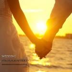 Wedding couple holding hands on Wellington beach.