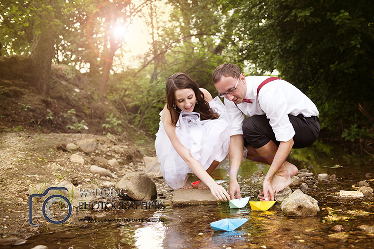 Making paper boat on their wedding day.