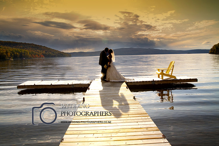 Wedding photography on lake pier.