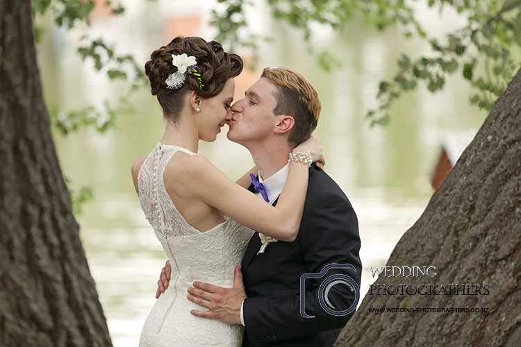 Special kiss in the park for by Central Wedding Photographers.